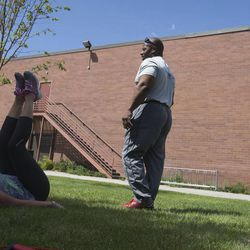 Ron Williams, a nondenominational Christian pastor, leads an exercise group of Utah National Guard members at their headquarters on Thursday, Aug. 14, 2014.