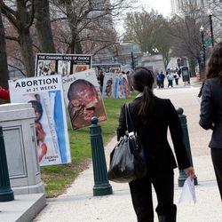 Anti-abortion activist Albert Stecklein III, left, attends rally opposing Planned Parenthood.