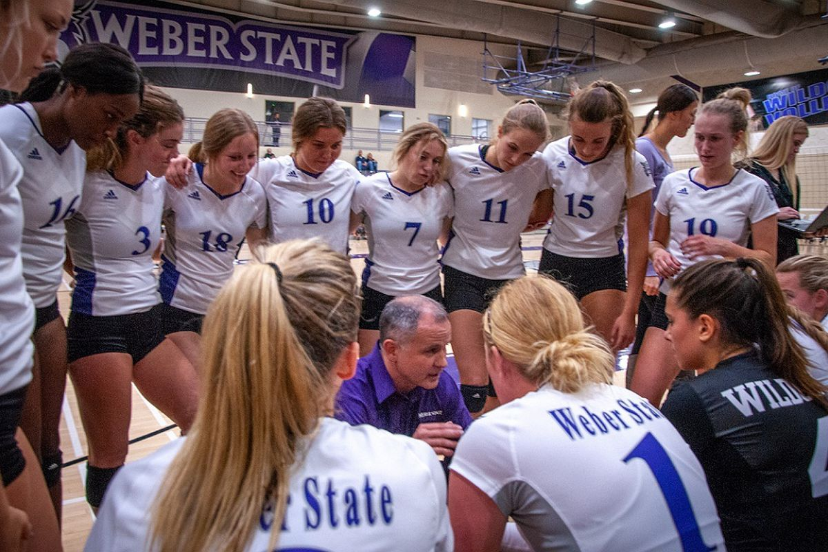 The Weber State women's volleyball team listens to head coach Jeremiah Larsen during a timeout in a match earlier this season. WSU fell in three sets to Sacramento State on Saturday night.