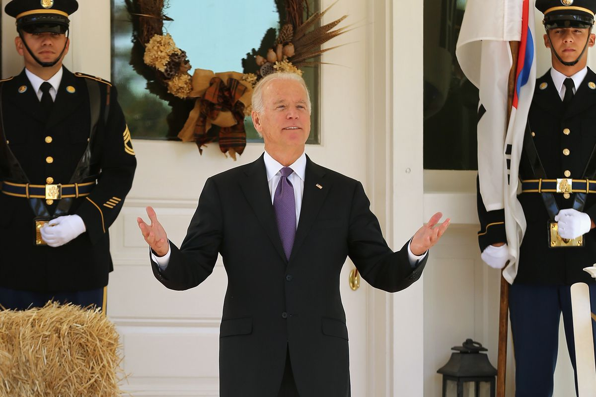 Vice President Joe Biden reacts to reporters' questions about him running for president while he waits for the arrival of President Park Geun-hye of South Korea at the Naval Observatory October 15, 2015, in Washington, DC.