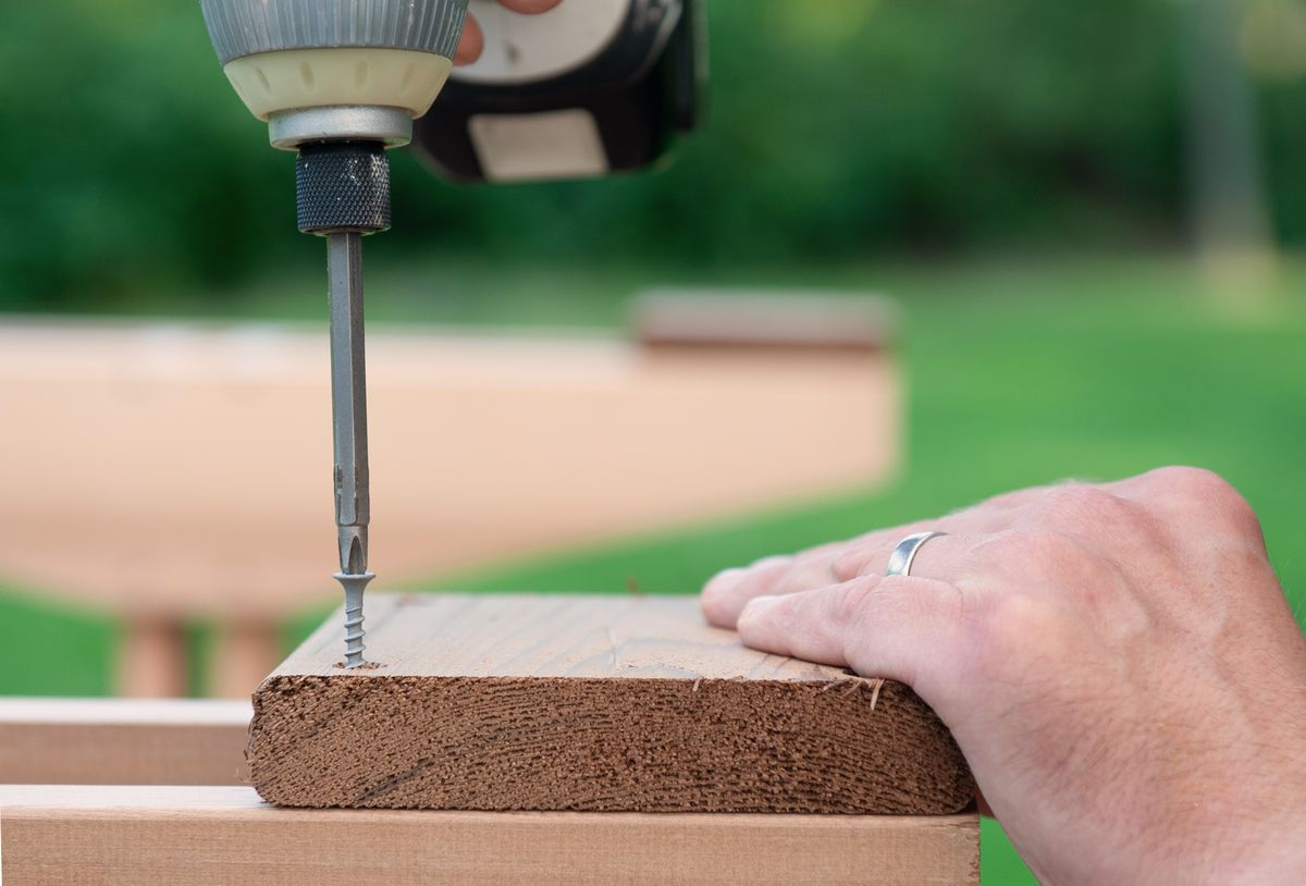 Man Attaches Foot Pads To Picnic Table