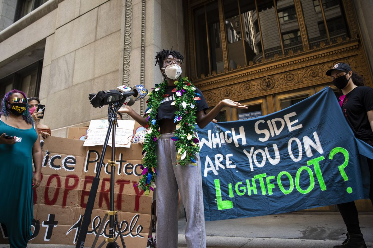 Community activist Destiny Harris speaks during a protest outside City Hall in the Loop to call for the city to defund the Chicago Police Department, Tuesday afternoon, Aug. 18, 2020. | Ashlee Rezin Garcia/Sun-Times