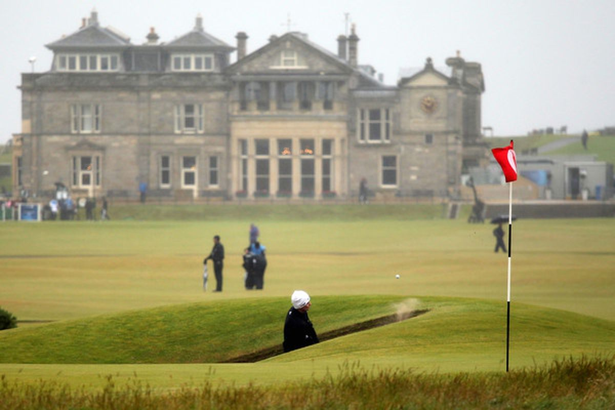 ST ANDREWS SCOTLAND - JULY 14:  Justin Rose of England hits a bunker shot during practice for the 139th Open Championship on the Old Course St Andrews on July 14 2010 in St Andrews Scotland.  (Photo by Warren Little/Getty Images)