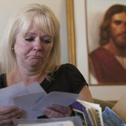 Barbara Huston reacts as she looks at photos of her sister's son, Darrien Hunt, who was killed by police Wednesday, at her home in Saratoga Springs, Friday, Sept. 12, 2014.