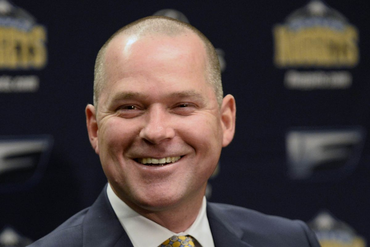One of many changes for this season's Nuggets, at the far end of the bench - Coach Michael Malone