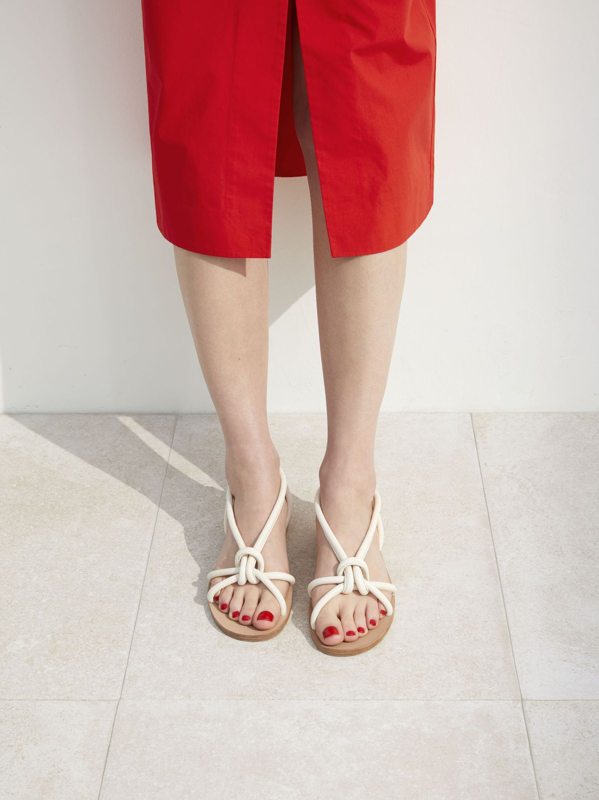 model in knotted strappy sandal