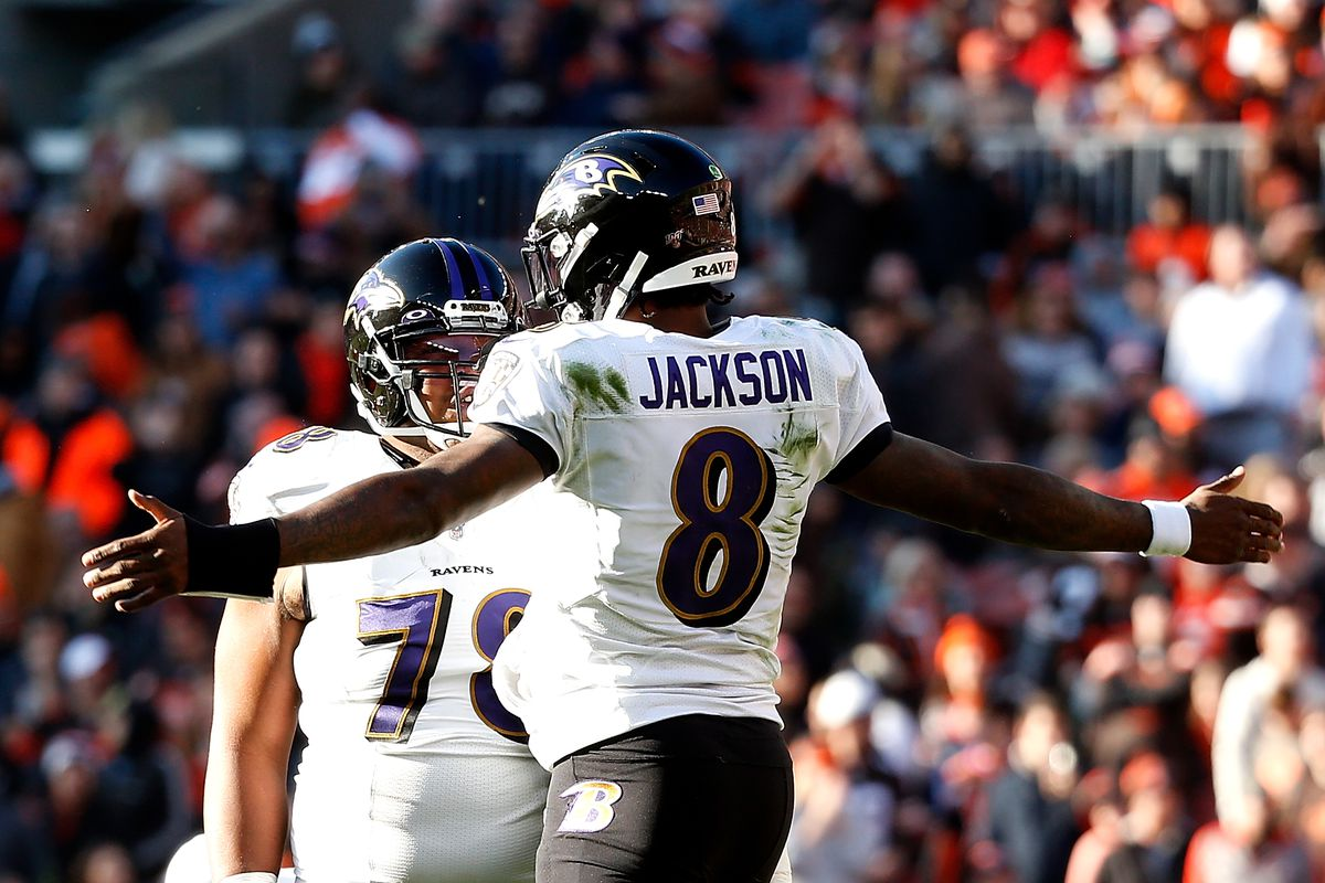 Lamar Jackson of the Baltimore Ravens celebrates with Orlando Brown Jr. after throwing a touchdown pass to Mark Andrews during the game against the Cleveland Browns at FirstEnergy Stadium on December 22, 2019 in Cleveland, Ohio.
