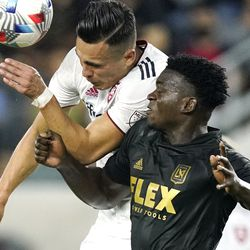 Real Salt Lake forward Rubio Rubin, left, and Los Angeles FC defender Jesus Murillo try to head the ball during the first half of a Major League Soccer match Saturday, July 17, 2021, in Los Angeles.