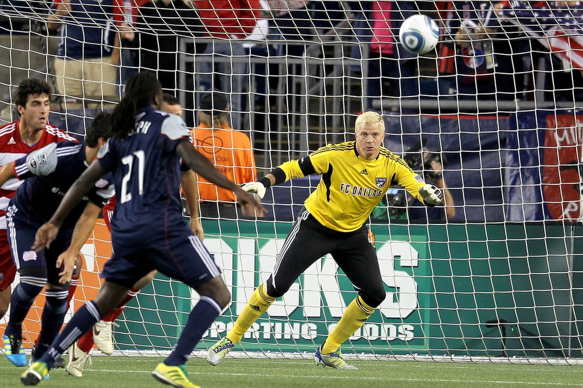FOXBORO, MA - SEPTEMBER 10:  Shalrie Joseph #21 of the New England Revolution presses goalie Kevin Hartman #1 of the FC Dallas react at Gillette Stadium on September 10, 2011 in Foxboro, Massachusetts. (Photo by Jim Rogash/Getty Images)