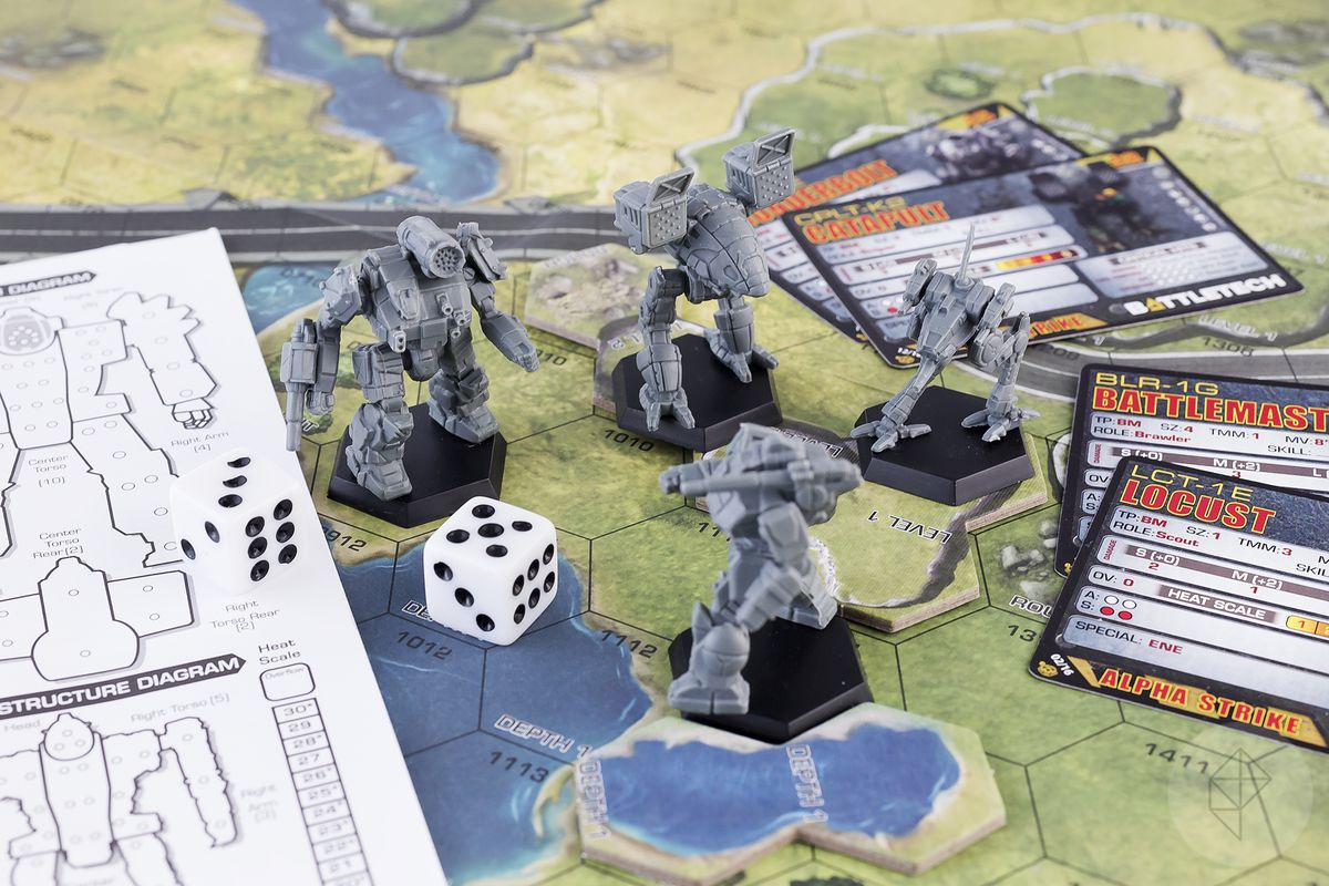 BattleTech miniatures, dice, and cards on a game board