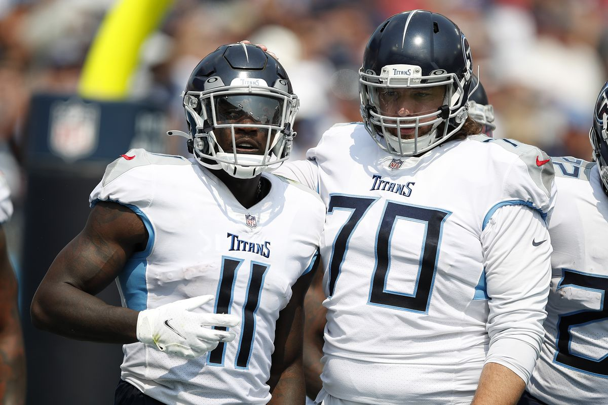 A.J. Brown #11 of the Tennessee Titans celebrates after his touchdown with Ty Sambrailo #70 during the third quarter against the Arizona Cardinals at Nissan Stadium on September 12, 2021 in Nashville, Tennessee.