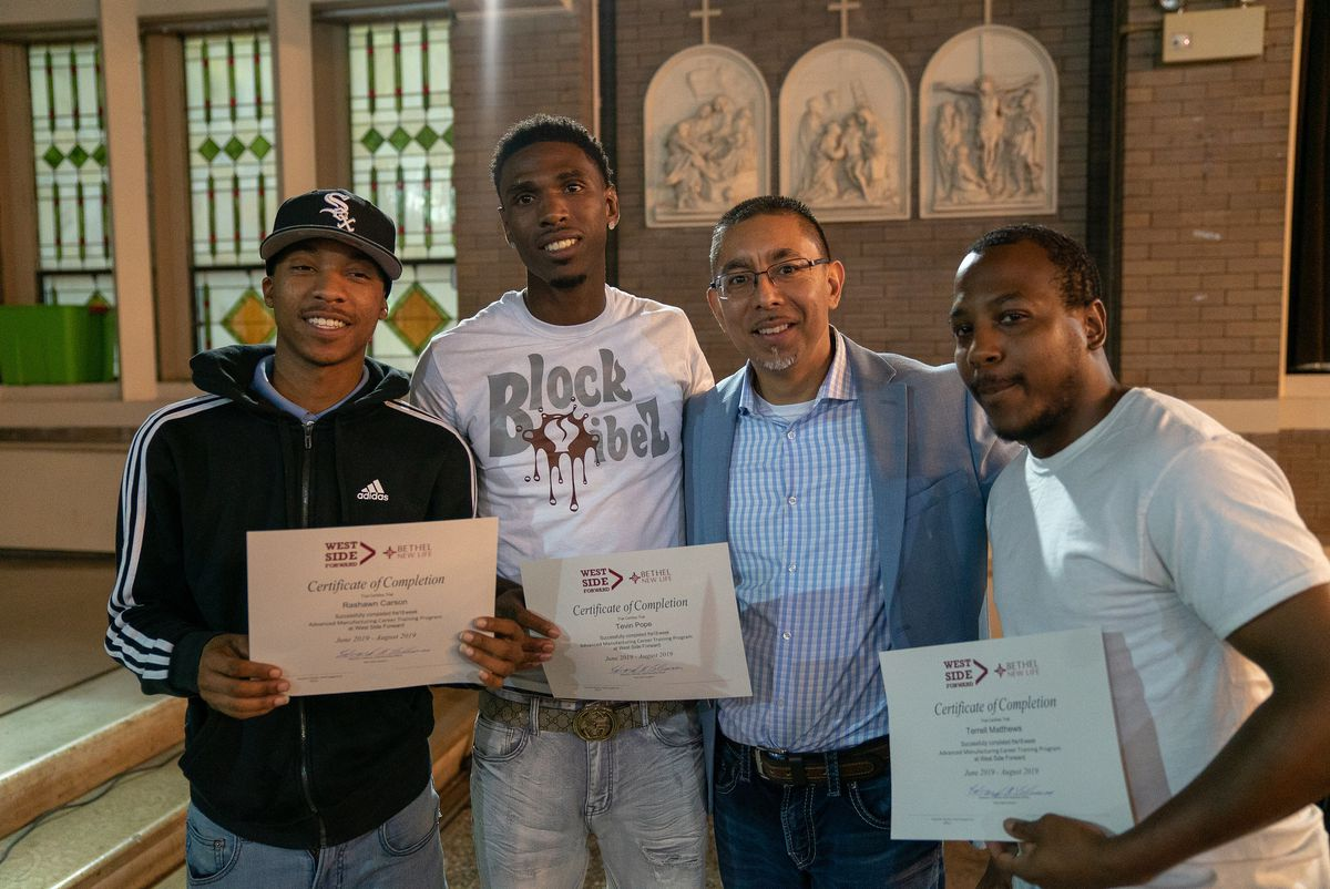 READI Chicago got a $2 million grant from JPMorgan Chase on May 5 to support its response to reduce gun violence through behavioral therapy, jobs, training and other support services. Seen here (from left) are program participants Rashawn Carson and Tevin Pope, senior director Eddie Bocanegra and participant Terrell Matthews.