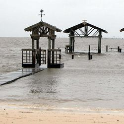 Storm surge, coupled with high tide, leaves  a pier on East Beach in Ocean Springs nearly submerged as Tropical Storm Cindy moves onshore in Ocean Springs, Miss., Wednesday, June 21, 2017.