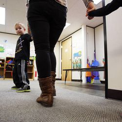 Henry, left, walks out for a drink with tutor Jayme Duringer and Hazel during the Autism Bridges program at Kids on the Move in Orem, Tuesday, Oct. 15, 2013.