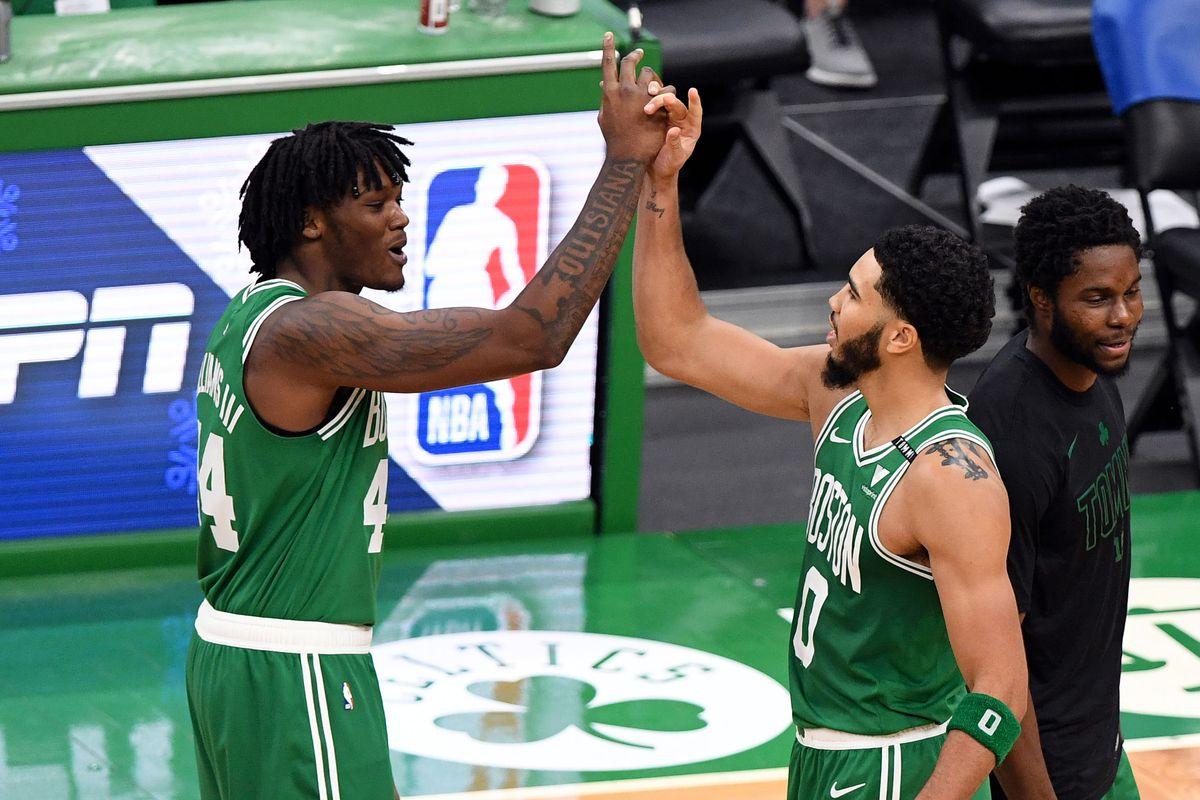 Jayson Tatum and Robert Williams III of the Boston Celtics celebrate after defeating the Milwaukee Bucks at TD Garden on December 23, 2020 in Boston, Massachusetts.