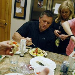Kyle Whittingham has dinner with his family at their home in Sandy on Thursday. His wife, Jamie, is behind him and daughter Kylie to the right.
