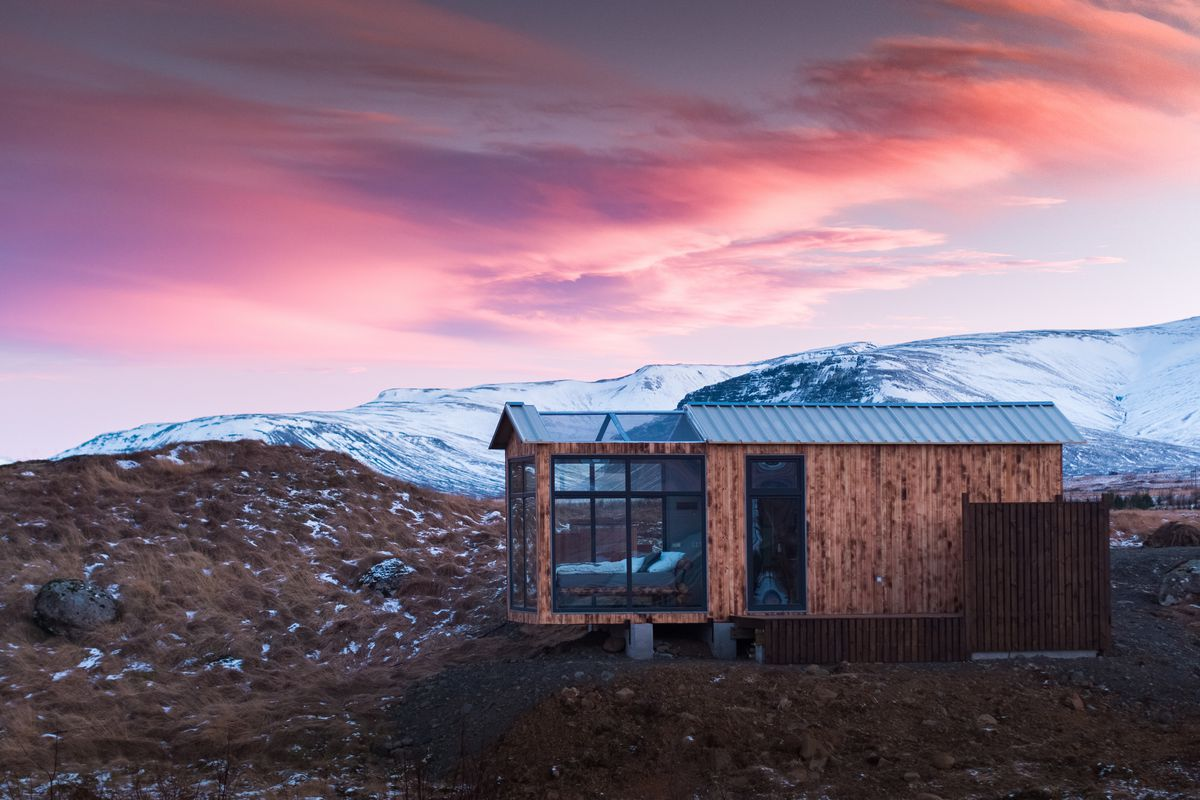 View of wood cabin during sunset