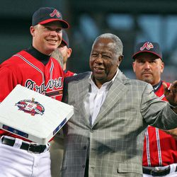 Atlanta Braves Hall of Famer Hank Aaron,right, presents Chipper Jones,left, with third base during his tribute night at Turner Field in Atlanta on Friday, Sept. 28, 2012.