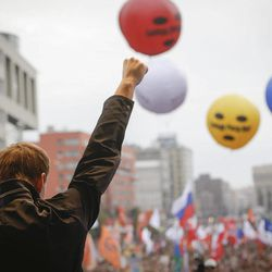 Opposition leader Alexei Navalny speaks at a protest rally in Moscow, Saturday, Sept. 15, 2012. Thousands of protesters marched across downtown Moscow on Saturday in the first major rally in three months against President Vladimir Putin, while defying the Kremlin's ongoing efforts to crackdown on opposition. Color balloons with the words Freedom to Pussy Riot refer to the three members of the punk band Pussy Riot  sentenced for two years in prison for performing an anti-Putin song inside Moscow's main cathedral.  AP Photo/Sergey Ponomarev)
