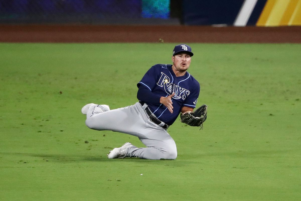 Hunter Renfroe #11 of the Tampa Bay Rays makes a diving catch to out Kyle Tucker #30 of the Houston Astros during the eighth inning in Game Three of the American League Championship Series at PETCO Park on October 13, 2020 in San Diego, California.