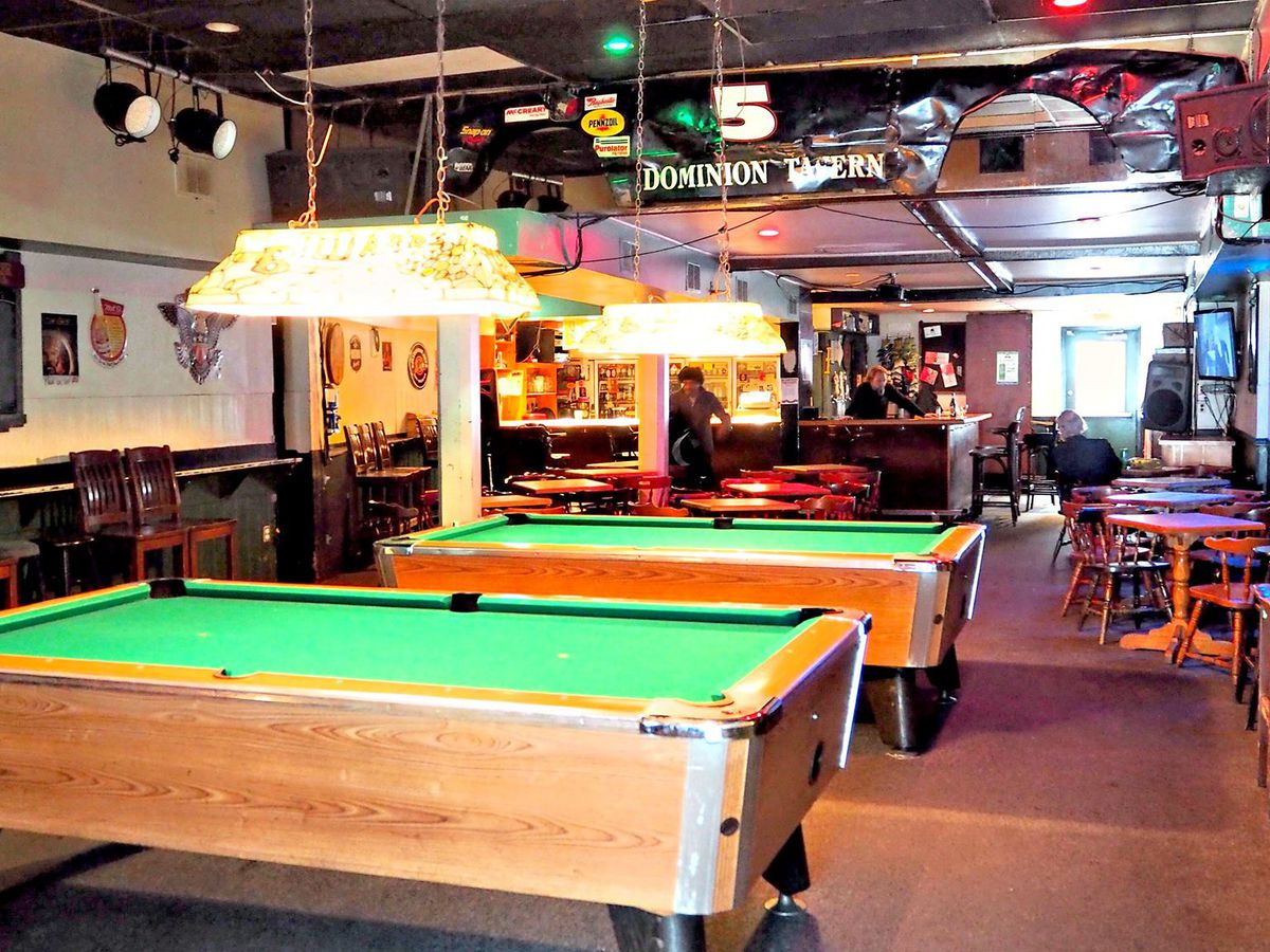 Pool tables in a dive bar.