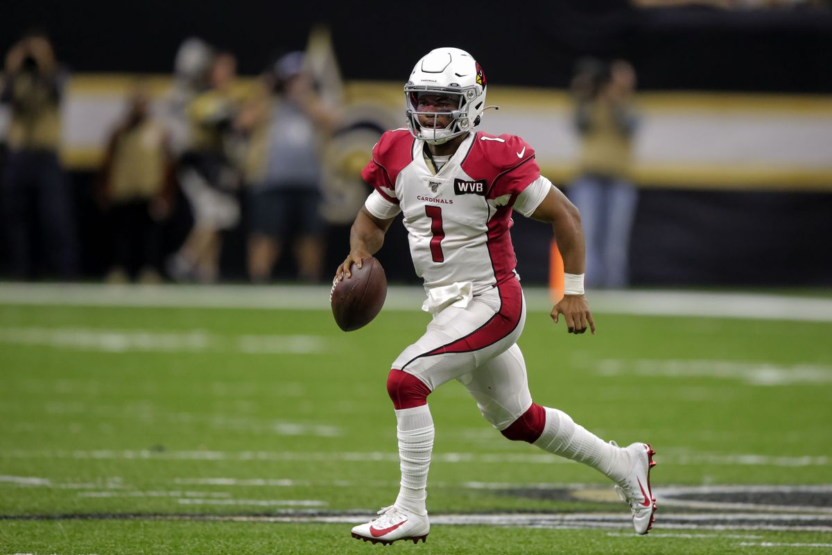 Arizona Cardinals quarterback Kyler Murray scrambles away from New Orleans Saints pass rush during the fourth quarter at the Mercedes-Benz Superdome.
