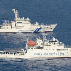 Ships of China Marine Surveillance and Japan Coast Guard sail side by side near disputed islands, called Senkaku in Japan and Diaoyu in China, in the East China Sea Tuesday afternoon, Sept. 18, 2012. The disagreement between the two countries escalated last week when the Japanese government said it was purchasing some of the islands from their private owner.