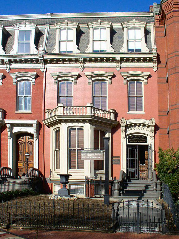 The exterior of the Mary McLeod Bethune Council House in Washington D.C. The facade is red with white decorative trim on the windows and door.