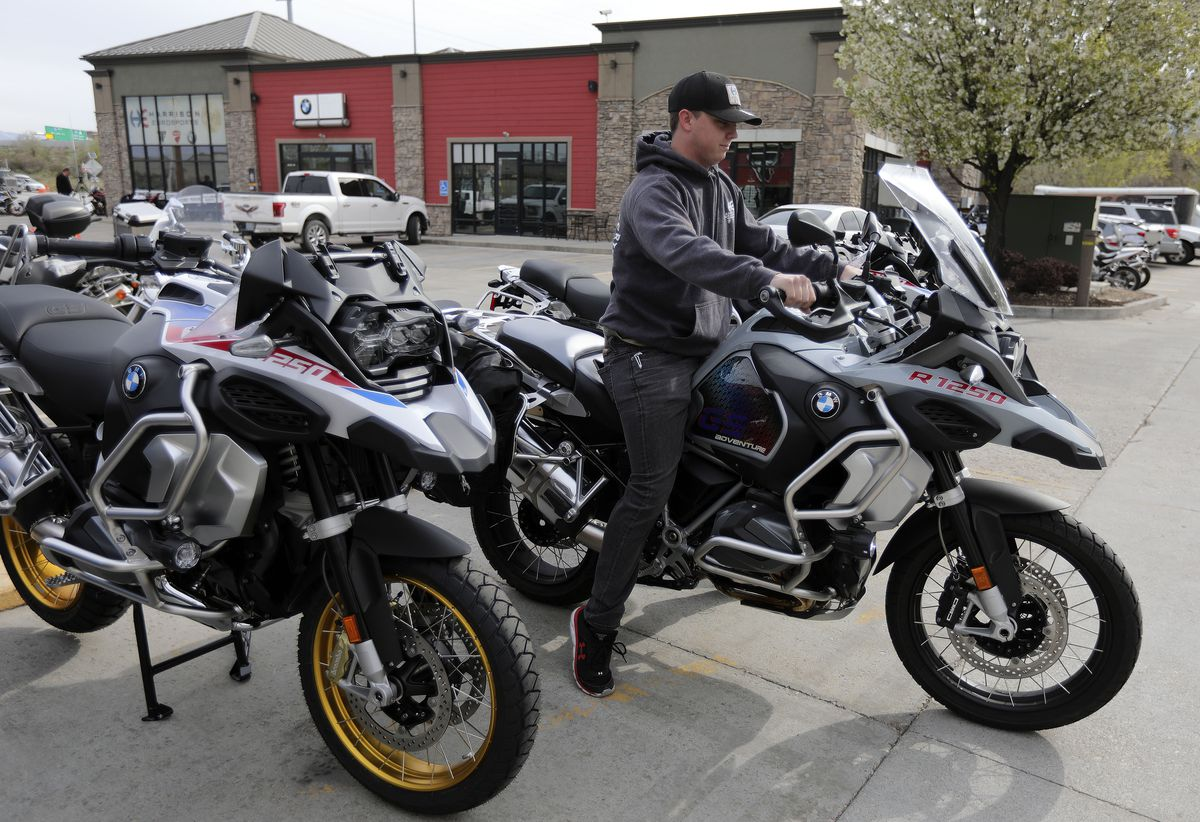 Austin Baskett, Harrison Eurosports lot technician, moves a used motorcycle to another area of the shop in Sandy on Wednesday, April 21, 2021. The Utah Department of Transportation is launching a Ride to Live motorcycle safety campaign.