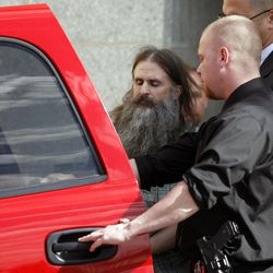Elizabeth Smart kidnapper Brian Mitchell is escorted out of the Salt Lake City Federal Courthouse after his first federal court appearance on Monday October 20, 2008.