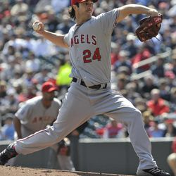 Los Angeles Angels' pitcher Dan Haren throws against the Minnesota Twins in the first inning of a baseball game Thursday, April 12, 2012, in Minneapolis.