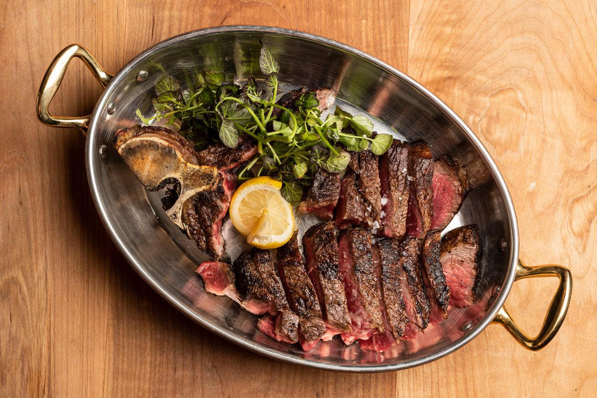 Dry-aged bistecca from Fia Steak in Santa Monica in a metal pan.