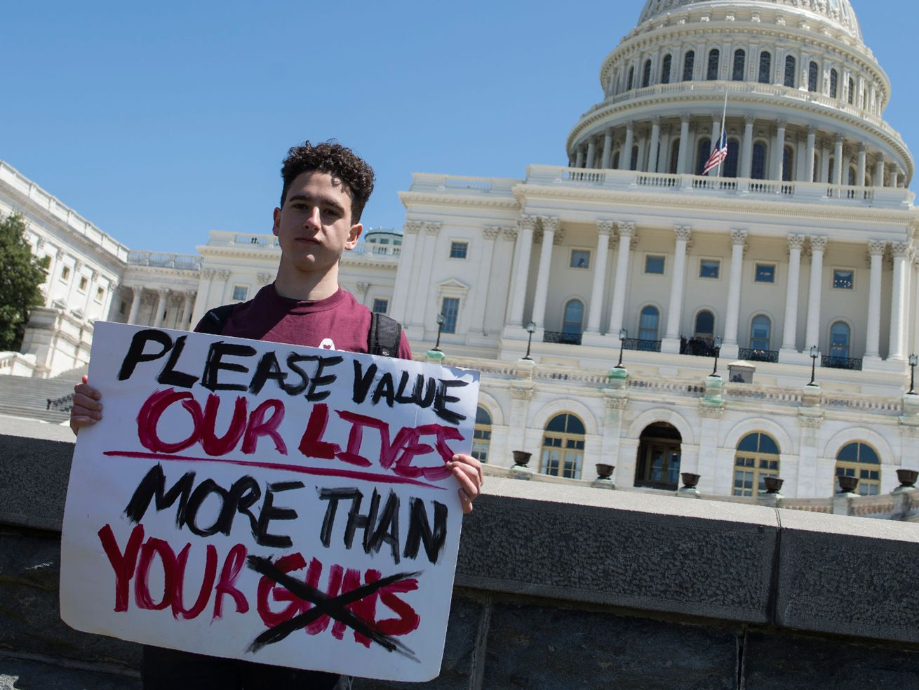 Amit Dadon, a graduate in 2017 from Marjory Stoneman Douglas High School, poses for a photo on the West Lawn of the U.S. Capitol after rallying in April 2018 with several hundred fellow students to call for stricter gun laws in Washington, D.C.