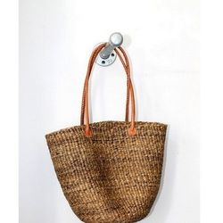 """Talk about a classic summertime staple. This <a href=""""http://vagabondboutique.bigcartel.com/product/design-africa-straw-tote"""">Design Africa Banana Fiber Tote</a> ($36) from Vagabond is perfect, whether you're sweltering in the subway, catching up with fri"""