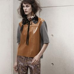 Pants, $79.95; Leather Top, $149; Silk scarf, $19.95; Sequin Collar, $19.95