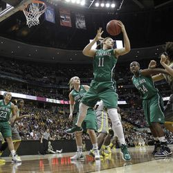 Notre Dame forward Natalie Achonwa (11) pulls in a rebound during the first half in the NCAA Women's Final Four college basketball championship game against the Baylor, in Denver, Tuesday, April 3, 2012.  (AP Photo/Eric Gay)