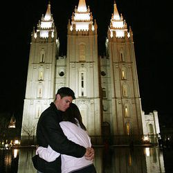 Paul James, Magna, and Alex Luna, Nashville, Tenn., console each other near Temple Square and the reflecting pond on Sunday after announcement of the death of President Gordon B. Hinckley.
