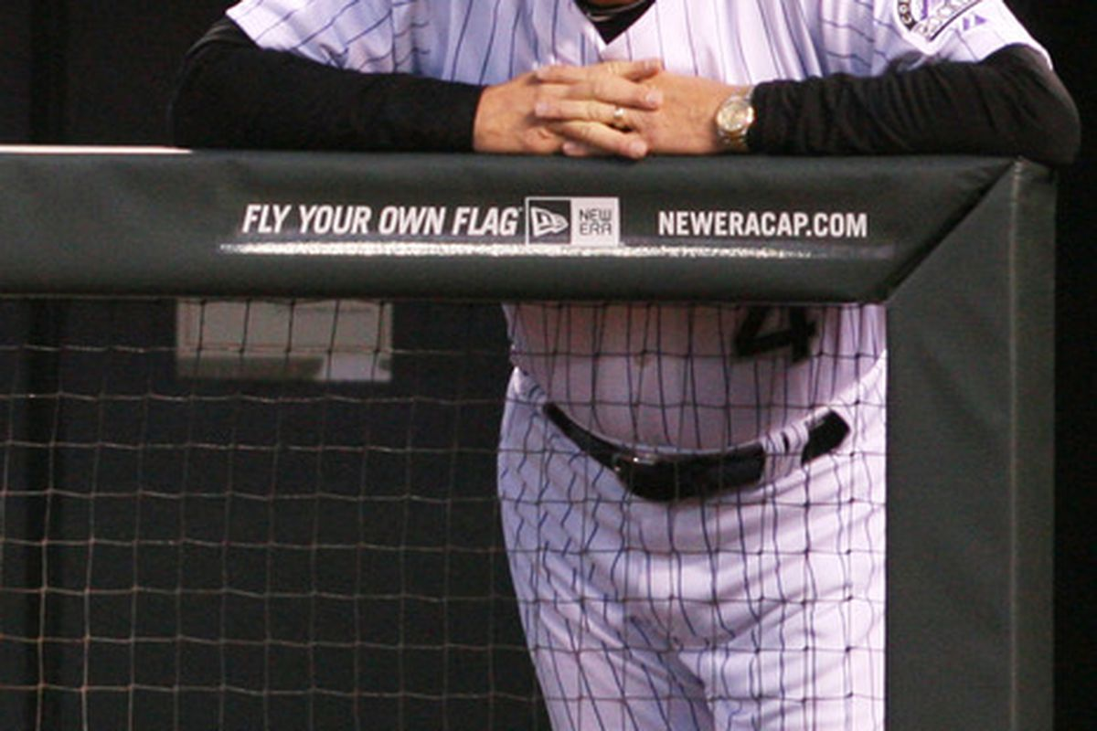 April 11, 2012; Denver, CO, USA; Colorado Rockies manager Jim Tracy watches from the duggout during the third inning against the San Francisco Giants at Coors Field.  Mandatory Credit: Chris Humphreys-US PRESSWIRE
