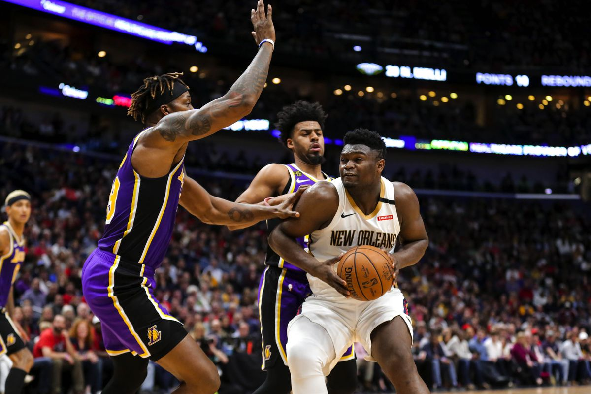 New Orleans Pelicans forward Zion Williamson drives to the basket against Los Angeles Lakers center Dwight Howard during the fourth quarter at the Smoothie King Center.