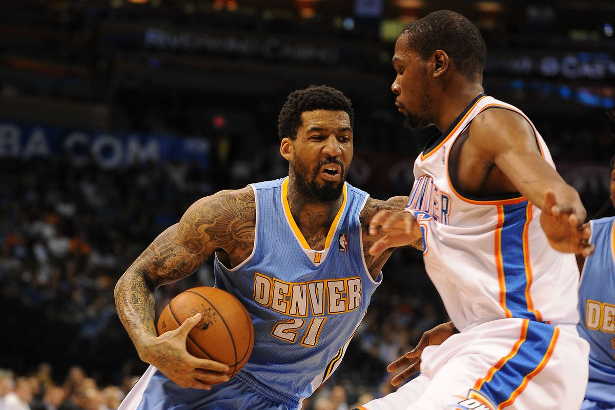 Wilson Chandler drives to the lane, with a stiff arm, against Kevin Durant.