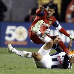 Javier Morales of Real Salt Lake fights for control of the ball against Hector Miguel Morales from the Rayados of Monterrey during the final game of the CONCACAF championship at Rio Tinto Stadium in Sandy Wednesday, April 27, 2011.