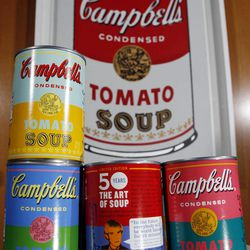 FILE-In this Aug. 24, 2012, file photo, new limited edition Campbell's tomato soup cans with art and sayings by artist Andy Warhol are displayed at Campbell Soup Company in Camden, N.J. Campbell Soup Co. announced Tuesday, Sept. 4, 2012, that net income rose 27 percent in its fiscal fourth quarter. The results beat analysts' expectations and the food maker gave fiscal 2013 revenue guidance above Wall Street's view.
