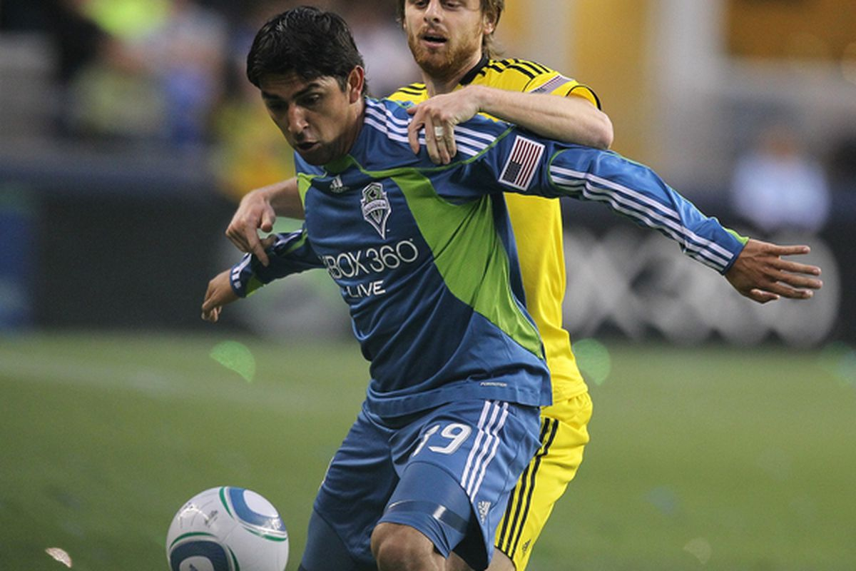 SEATTLE - MAY 01:  Leonardo Gonzalez #19 of of the Seattle Sounders FC battles Eddie Gaven #12 of the Columbus Crew on May 1, 2010 at Qwest Field in Seattle, Washington. (Photo by Otto Greule Jr/Getty Images)