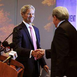 Salt Lake City Mayor Ralph Becker, left, and Airport Board Chairman Michael Gallivan shake hands as new Salt Lake City International Airport terminal design details are unveiled in Salt Lake City, Tuesday, Sept. 29, 2015.