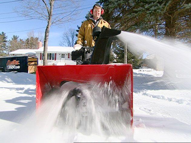 Kevin rides a snowblower