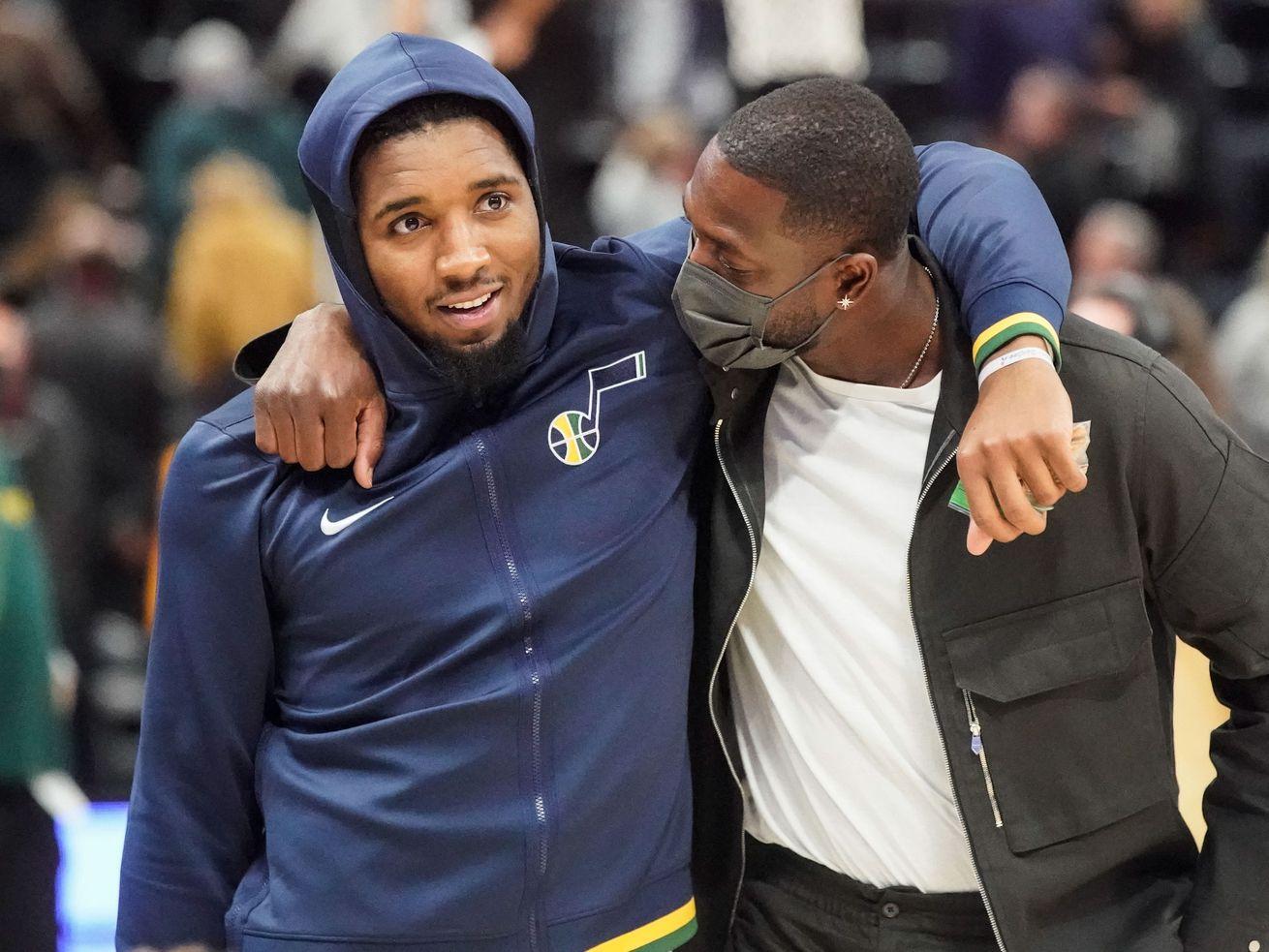 Utah Jazz guard Donovan Mitchell and Utah Jazz minority owner Dwayne Wade talk