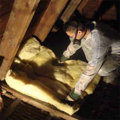 Man Lays New Insulation In Attic After Cleaning Out Bats