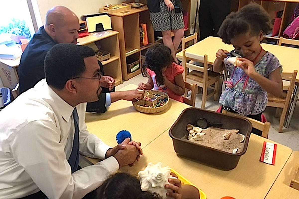 U.S. Secretary of Education John King interacts with children at the Mile High Learning Center.