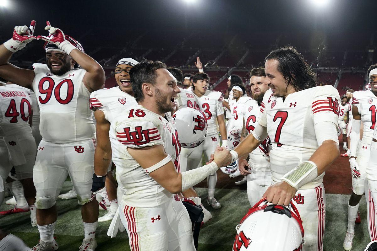 Utah quarterback Cameron Rising wide receiver Britain Covey shake hands