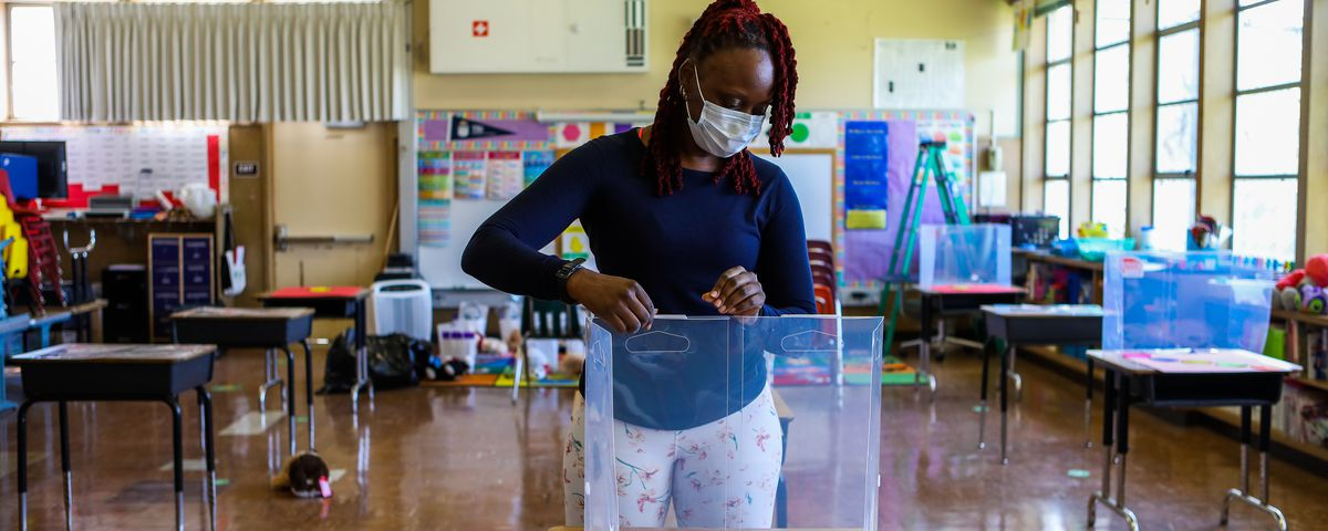 OAKLAND, CA - MARCH 25: Shaione Simmons, who teaches transitional kindergarten and kindergarten, builds a cough box as she preps her classroom at Madison Park Academy Primary on Thursday, March 25, 2021, in Oakland, Calif. The school is preparing to reopen on March 30. (Yalonda M. James/The San Francisco Chronicle via Getty Images)